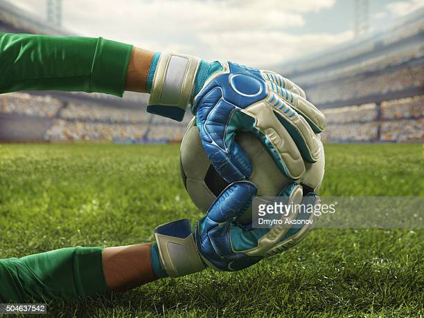 soccer goalkeeper catches a ball - goalie goalkeeper football soccer keeper stock pictures, royalty-free photos & images