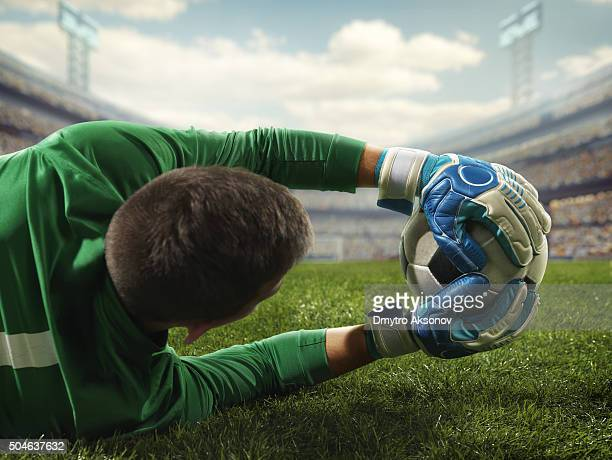 soccer goalkeeper catches a ball - goalkeeper stock pictures, royalty-free photos & images