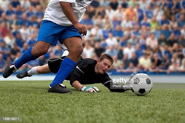 soccer goalkeeper defending goal