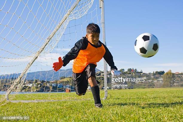 soccer goalkeeper diving for ball - ゴールキーパー ストックフォトと画像