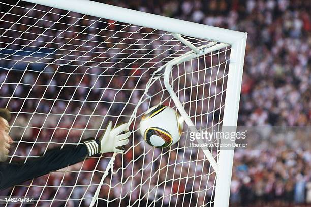 soccer goalkeeper diving to block ball - tirare in rete foto e immagini stock