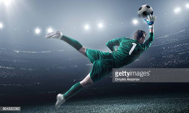 soccer goalkeeper in a jump - penalty kick stock pictures, royalty-free photos & images