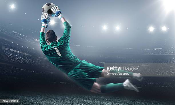 soccer goalkeeper in a jump - goalie goalkeeper football soccer keeper stock pictures, royalty-free photos & images