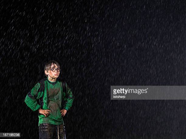 Soccer goalkeeper in the rain