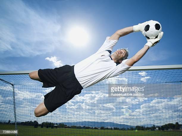 Soccer goalkeeper making diving save