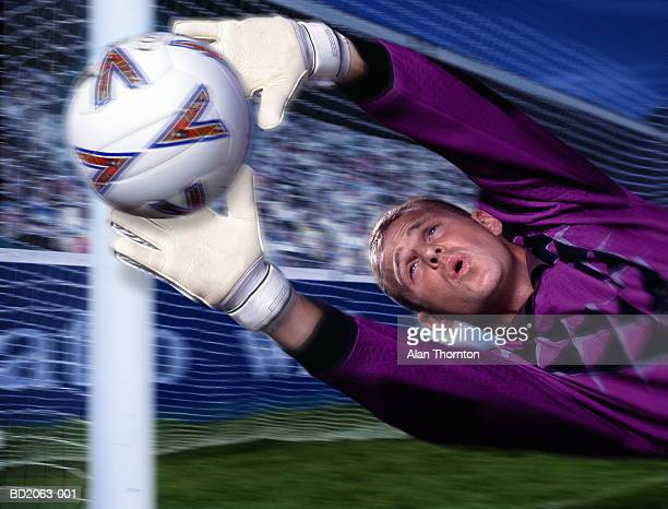 soccer goalkeeper making save, close-up (digital enhancement) - making a save sports stock pictures, royalty-free photos & images
