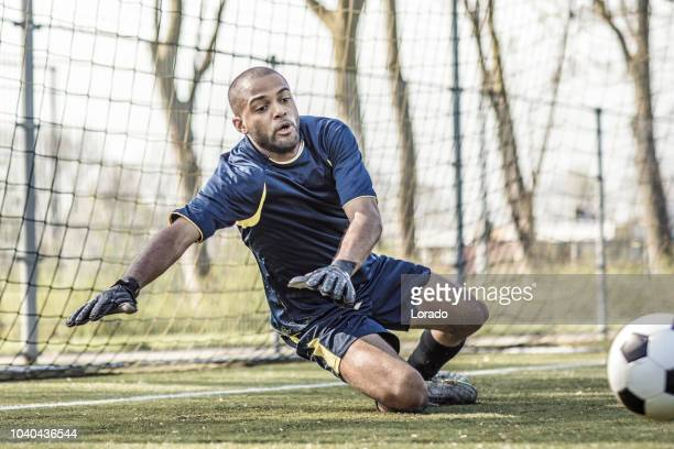 soccer goalkeeper - diving to the ground stock pictures, royalty-free photos & images
