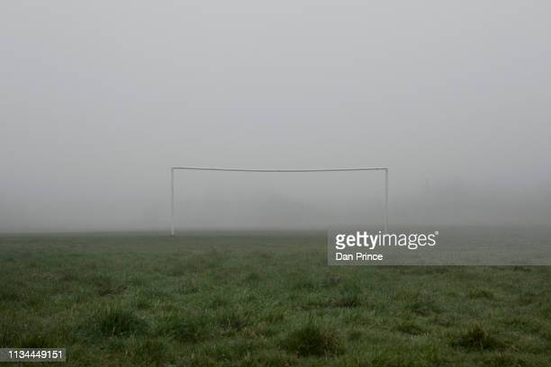 soccer goalpost in mist - football pitch stock pictures, royalty-free photos & images