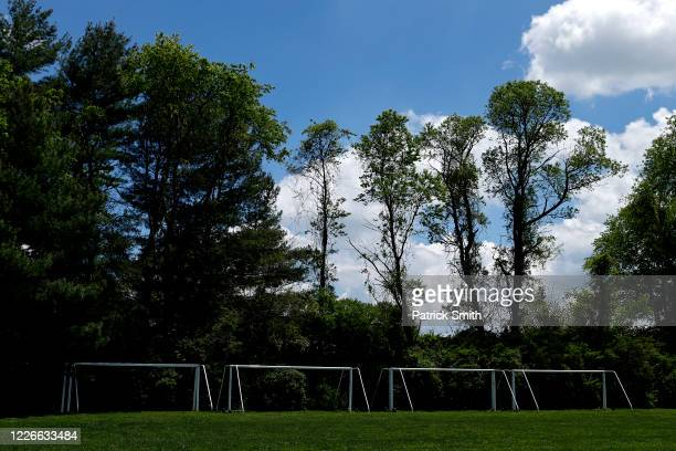 Soccer goals are seen stored away during lockdowns due to the ongoing Coronavirus pandemic on May 23, 2020 in Hydes, Maryland. While Maryland Gov....