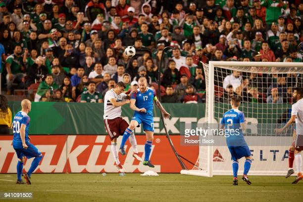 Iceland Aron Gunnarsson in action heading ball vs Mexico Hector Moreno during International Friendly at Levi's Stadium San Francisco CA CREDIT Robert...
