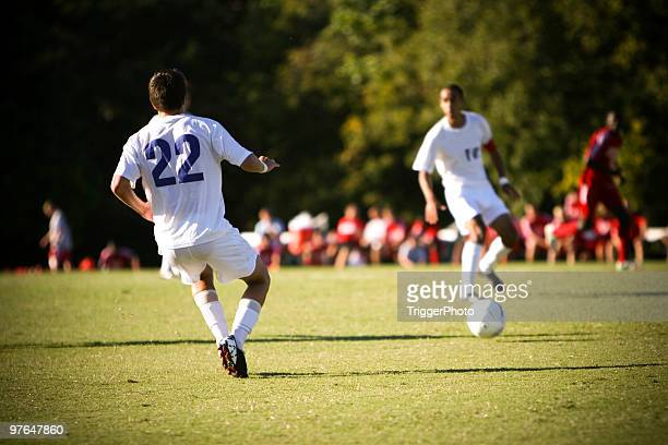 Soccer imagery with players in white uniforms