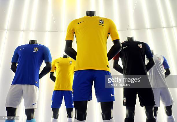Soccer jersey for the US and Brazil made by Nike are pictured during an unveiling event in New York on March 17 2016 / AFP / Jewel SAMAD
