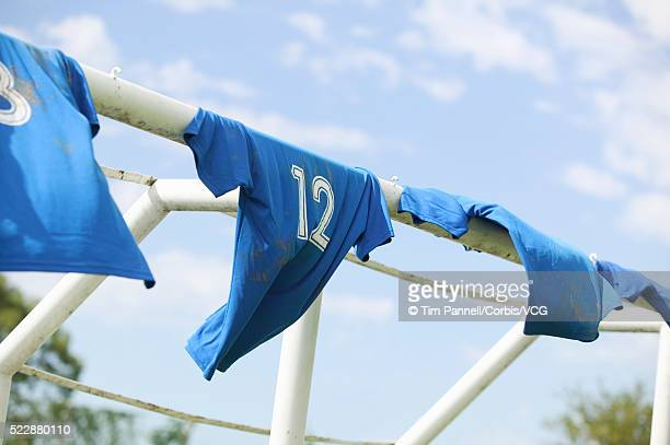 soccer jerseys hanging on goal - sports jersey stock pictures, royalty-free photos & images