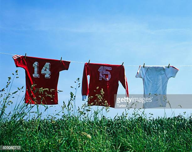 soccer jerseys on clothesline - sports jersey stock pictures, royalty-free photos & images