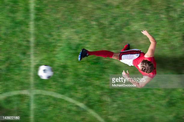 soccer kick - kicking stock pictures, royalty-free photos & images