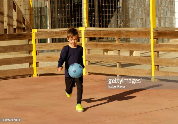 Soccer kid playing with soccer ball
