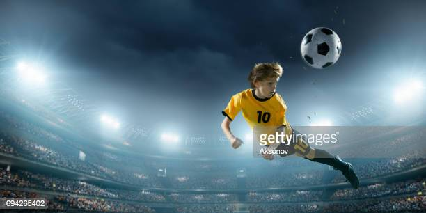 Soccer kids player in action in 3D dramatic stadium