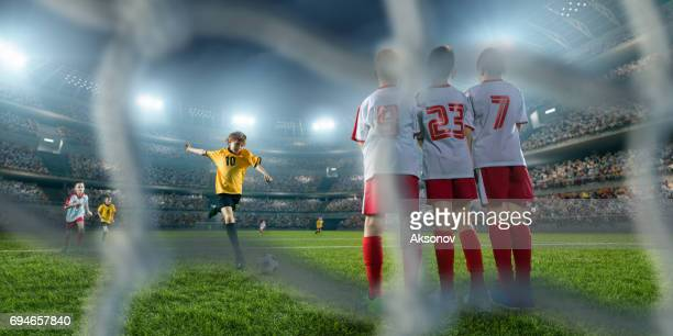 soccer kids player makes a free kick - penalty kick stock pictures, royalty-free photos & images