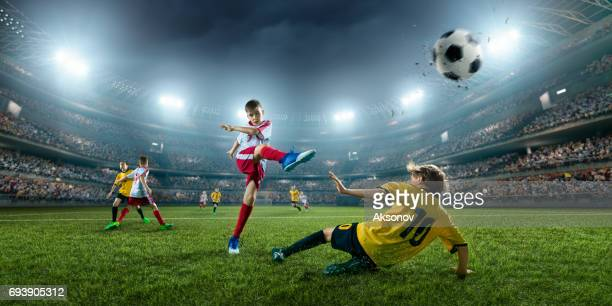 Soccer kids players in action in 3D dramatic stadium