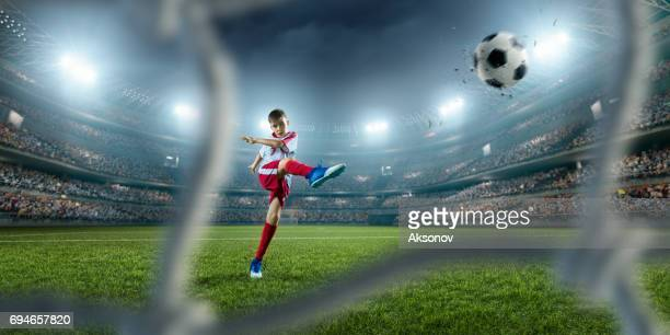 soccer kids players scoring a goal - kicking stock pictures, royalty-free photos & images