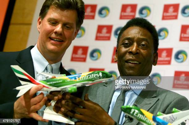 Soccer legend Pele and Seamus O'Brien Chairman of New York Cosmos soccer club pose with a model of Emirates plane sporting the colors of Brazilan...