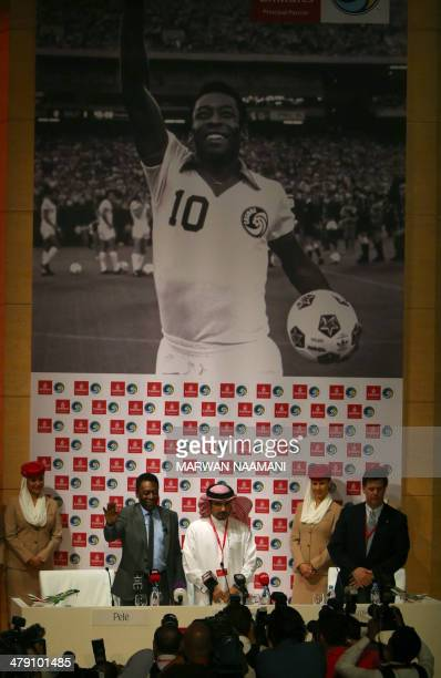 Soccer legend Pele gestures as he arrives for a special screening of the iconic Brazilian player's greatest moments at Emirates headquarters in Dubai...