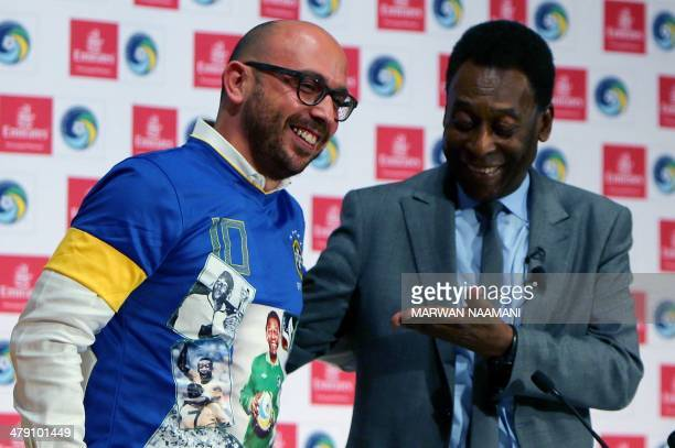 Soccer legend Pele looks at a fan wearing a customised Pele Tshirt during a special screening of the iconic Brazilian player's greatest moments at...