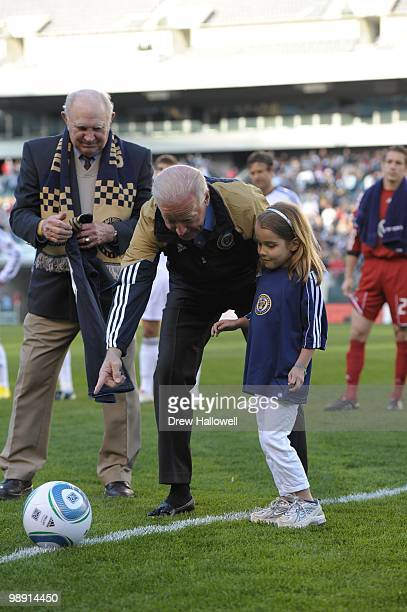 Soccer legend Walter Bahr looks on as Vice President Joe Biden and Biden's granddaughter Natalie Biden five look at the soccer ball before the game...