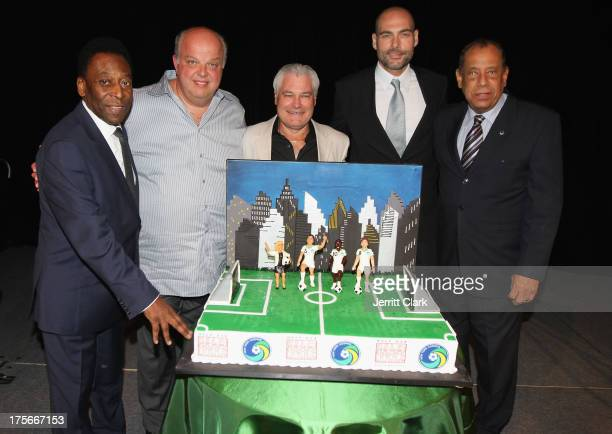 Soccer Legends Pele and Carlos Alberto Torres pose with Cake Boss stars at the New York Cosmos Legends Gala at Gotham Hall on August 1 2013 in New...