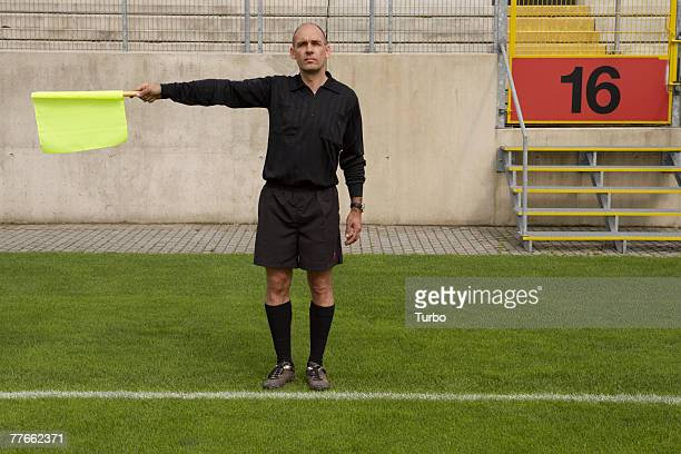 Soccer Linesman Referee Holding Flag