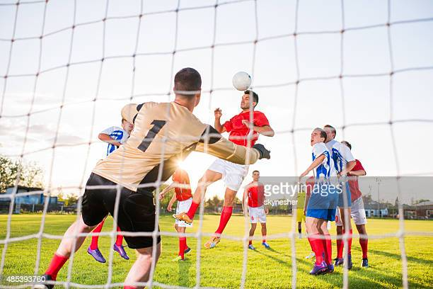 Soccer match from the goalkeeper's net.
