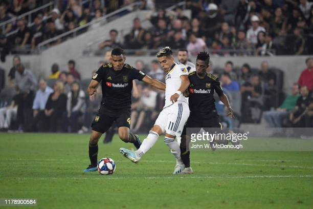 MLS Playoffs Los Angeles Galaxy Favio Alvarez in action vs Los Angeles FC Eddie Segura and Latif Blessing at Banc of California Stadium Los Angeles...