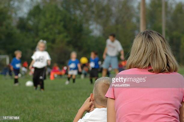 Soccer Mom and Brother Watching Sister Play Game