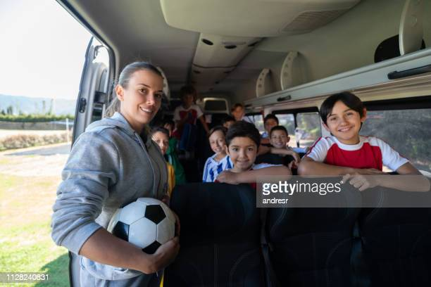 soccer mom transporting kids to summer camp in a van - sports training camp stock pictures, royalty-free photos & images