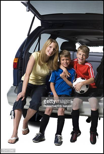 Soccer mom with sons