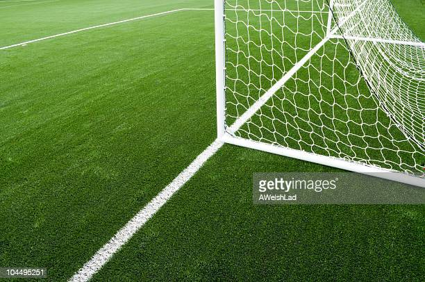 Soccer net and field on bright green artificial turf