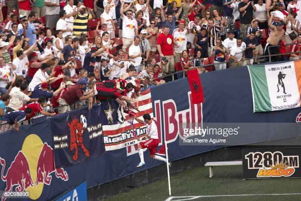 New York Red Bulls Juan Pablo Angel victorious with fans after scoring goal during game vs Los Angeles Galaxy. East Rutherford, NJ 7/19/2008 CREDIT:...