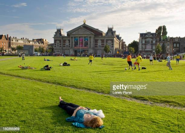 soccer on museumplein with concertgebouw in background. - museumplein stock pictures, royalty-free photos & images