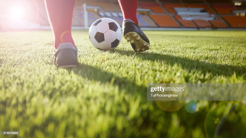 soccer or football player standing with ball on the field for Kick the soccer ball at football stadium : Stock Photo