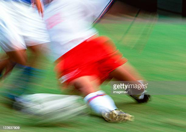 soccer - slide tackle stock pictures, royalty-free photos & images
