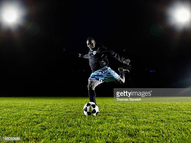 soccer player about to kick ball on field - rush american football stock pictures, royalty-free photos & images