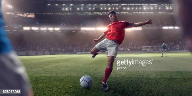 soccer player about to take free kick during football game - chutar imagens e fotografias de stock