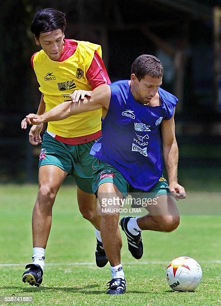 Soccer player Alberto Garcia Aspe fights for the ball with his teammate of Mexico Alberto Rodriguez 19 July 2001 during practice in Cali Colombia El...
