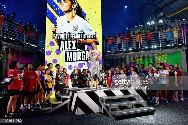 Soccer player Alex Morgan accepts the Favorite Female Athlete award onstage during the Nickelodeon Kids' Choice Sports 2018 at Barker Hangar on July...