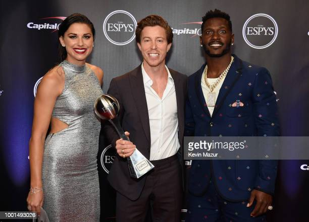 Soccer player Alex Morgan snowboarder Shaun White recipient of the award for Best Male US Olympian and NFL player Antonio Brown attend The 2018 ESPYS...