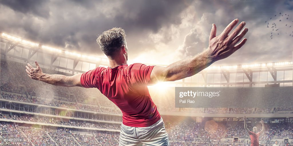 Soccer Player Arms Wide Celebrating After Scoring Goal in Match : Stock Photo
