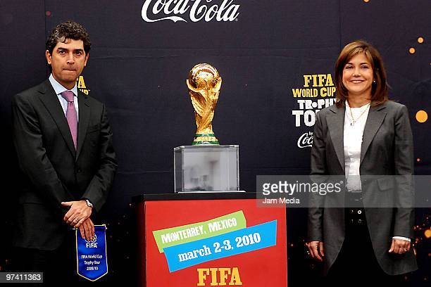 Soccer player Arturo Gutierrez and Maria Eugenia del Rio pose for a photo aside the Fifa World Cup Trophy during an exhibition as part of its world...