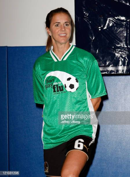 Soccer player Brandi Chastain teaches children about soccer and flu vaccinations at Super Soccer Stars Indoor Soccer Field on August 20 2009 in New...