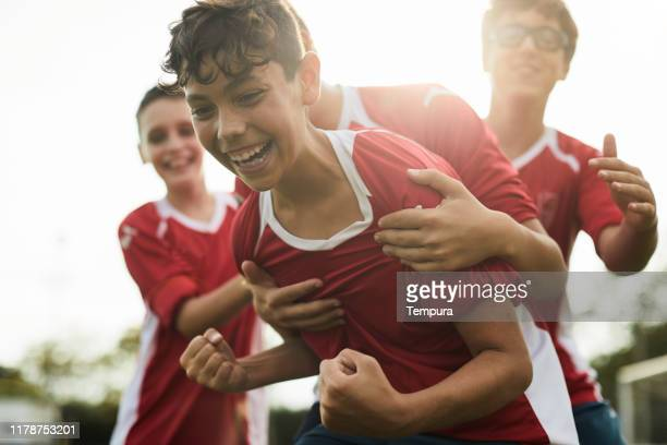 a soccer player celebrates a goal. - boys stock pictures, royalty-free photos & images