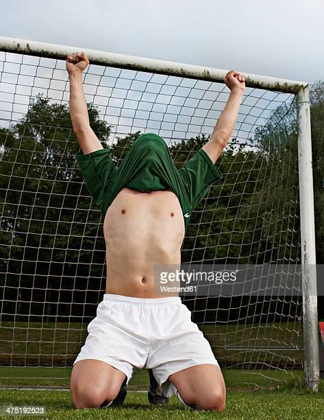 Soccer player celebrating on field